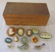 Wooden box containing various costume jewellery brooches etc
