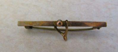 9ct gold wishbone brooch weight 1 g