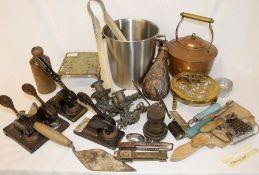 Selection of kitchenalia, copper powder flask, desk stamps, Batey bottle, candle sconces, cased