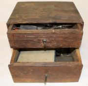 2 drawer cabinet containing watchmakers tools, keys and parts