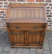 Oak bureau with linen fold panels