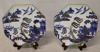 Pair of Wedgwood octagonal Willow pattern plates with gilt detail, impressed Portland mark, dia.