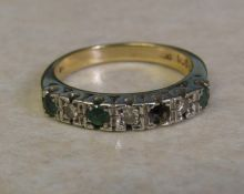9ct gold diamond and emerald ring (missing one emerald) size O weight 3.7 g
