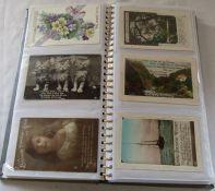 Postcard album containing 144 greetings postcards