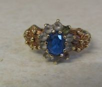 9ct gold cluster dress ring with blue and white coloured stones size P weight 3.2 g