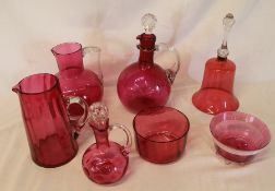 Cranberry glass decanters, jugs, bowls & bell