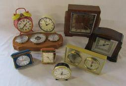 Various clocks and barometers