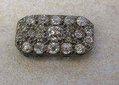 Broken clasp containing approximately 0.45 ct of diamonds (16 mm x 10 mm)