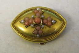 Tested as 14 ct gold memorial brooch decorated with coral and seed pearls, total weight 11.7 g, D 42