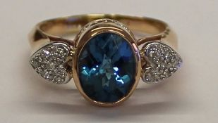 14K London blue topaz ring (3ct) set with heart shaped diamond chip shoulders, size R, weight