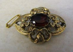 Tested as 9ct gold keepsake / memorial brooch with quartz stone and braided hair panel on reverse (