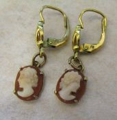 Pair of 9ct gold cameo drop earrings with yellow metal fasteners
