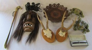 Tribal mask, Tasco 7 x 35 mm binoculars, mounted horns, Parker pen etc