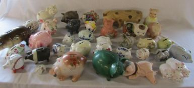 2 boxes of assorted ceramic and pottery pigs etc
