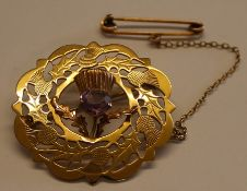 Ward Brothers 9ct gold Scottish thistle brooch with pierced decoration, central amethyst & safety