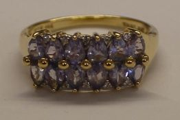 14k iolite ring with diamond accents size S, weight approximately 4.7g