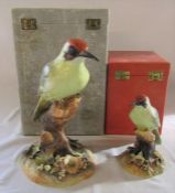 2 boxed Royal Crown Derby green woodpeckers H 24 cm signed M.E.T and H 15 cm signed M Dudley