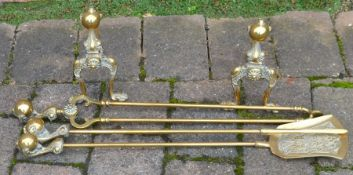 Pair of brass fire dogs & fire irons