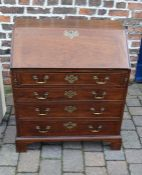 Small mahogany George III bureau with cock beading to the drawers, brass swan neck handles & bracket