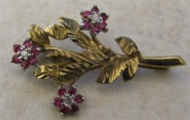 9ct gold diamond and ruby flower brooch weight 2.7 g