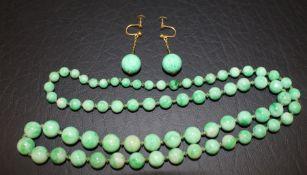 String of jade beads (31cm drop) & pair of screw-fit spherical jade earrings