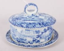 "An early 19th century Davenport ""Chinese Garden"" pattern oval butter dish and cover with integral"