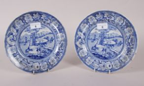 A pair of early 19th century blue and white transfer decorated dishes with figures and buildings, 9""