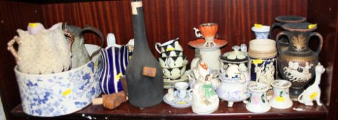 A pair of reproduction Greek white figure vases, two Victorian relief moulded jugs and other