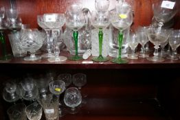 Two cut glass jugs, three cut glass decanters, eight cocktails and other table glass