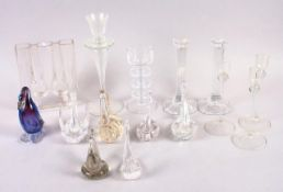 A pair of modernist glass candlesticks, a Wedgwood glass candlestick, a number of glass swans and