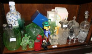 A Murano glass clown and a quantity of green coloured glass