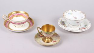 A Royal Worcester cabinet cup and saucer, painted fruit, by T Lockyer (chip to rim) and two other