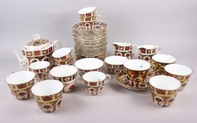 "A Royal Crown Derby ""Old Imari"" 1128 pattern teaset, comprising teapot, two sugar bowls, two cream"