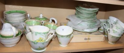 A New Chelsea green floral part teaset and a Mortlock's green and gilt decorated part teaset