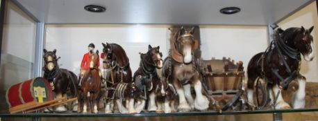 A Beswick model of a horse with jockey, other model horses and carriages, a Murano glass clown, an