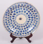 "An 18th century Delft plate with all-over leaf and tendril design, 12"" dia (rim chips)"