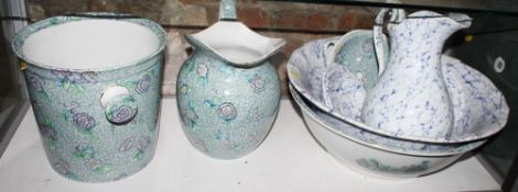 A Chintz decorated toilet set and another similar with blue marbled decoration