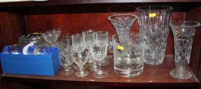 An etched glass ice bucket, vases, whisky tumblers, ashtrays and other glassware