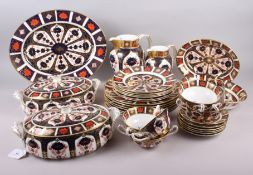 "A Royal Crown Derby ""Old Imari"" 1128 pattern part dinner service, comprising two vegetable tureens"