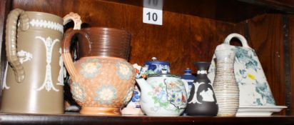 A brown transfer decorated toilet jug, another toilet jug and assorted decorative jugs, etc,