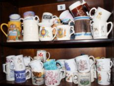 An assortment of commemorative and other mugs