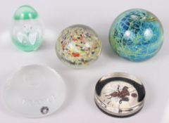A Mdina glass paperweight and four other paperweights, various