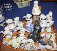 A small Lladro figure of a dozing cherub, a pair of Rosenthal white chine cherub candlesticks, a set
