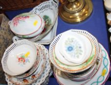 A collection of assorted ribbon plates and other decorative plates