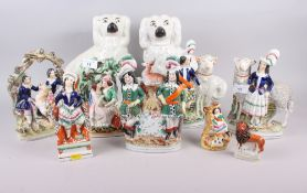 "A pair of 19th century Staffordshire spaniels, 11"" high, and eight Staffordshire pottery groups"