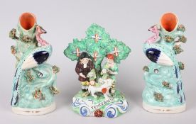 "A pair of 19th century Staffordshire spill vases, 8"" high (restorations), and a Staffordshire"