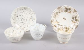 A Rockingham porcelain basket moulded trio decorated birds and foliage in grey and gilt, Pattern