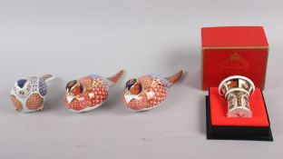 A pair of Royal Crown Derby paperweights, modelled as pheasants, gold stoppers, a similar
