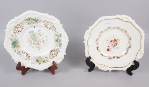 A Rockingham tureen stand, decorated ornate shell and gadroon border, centre painted floral