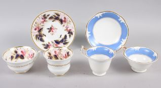 A Rockingham porcelain teacup, coffee cup and saucer with broad powder blue border and gilt edge,